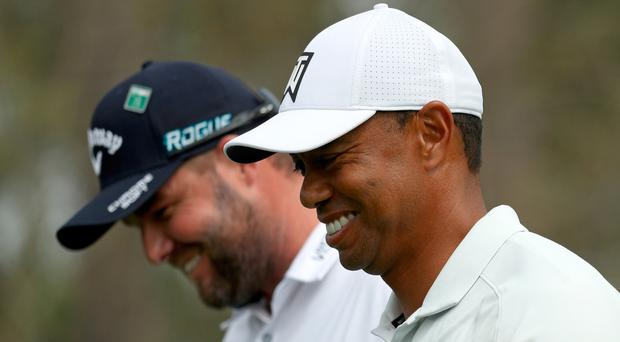 Tiger Woods shares a joke with Marc Leishman during the second round at Augusta