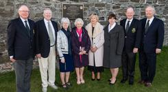 At the newly-erected plaque on the wall of Curley's Yard beside the third hole at Royal Dublin, to commemorate the birthplace of Michael Moran on the centenary of his death in World War I, (l to r) Kieran Howard (President), Thomas Curley, Ann Hickey, Molly Perry, Bernie O'Shaughnessy, Linda Byrne, Brian Purcell (Captain) and Peter Finnegan (Ex Officio)