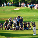 Rory McIlroy chips onto the 18th green on day three of the golf PGA Championship at Wentworth Photo: AFP/Getty