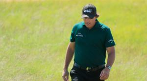 Phil Mickelson of the United States walks on the 18th green on Saturday. Photo: Getty Images