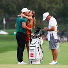 Brooks Koekpa is rewarded with a kiss from girlfriend Jena Sims after his victory in yesterday's final round of the USPGA. Photo: Getty