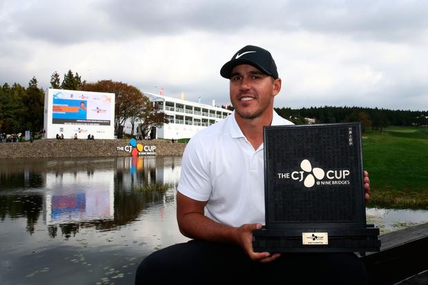 Number one: Brooks Koepka with the trophy after winning the CJ Cup at the Nine Bridges in Jeju, South Korea. Photo: Getty