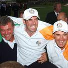 Pádraig Harrington celebrates with future Ryder Cup captains Darren Clarke and Paul McGinley at the 2002 event. Photo: Getty