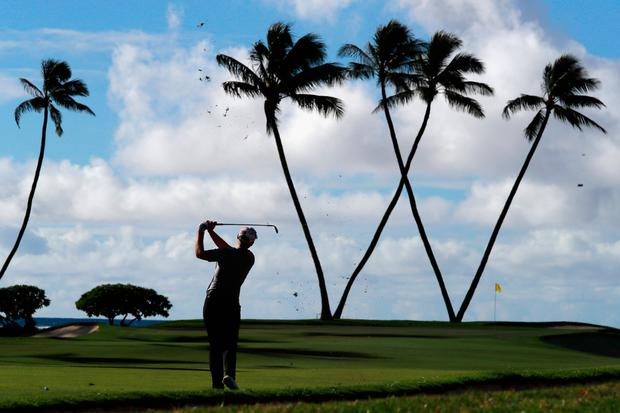 Seamus Power plays a shot into the 16th hole in the first round of the Sony Open in Hawaii. The Irishman shot a two-over par round of 72 to leave him lying 10 shots behind leader Andrew Putnam. Jordan Spieth, meanwhile, shot 73