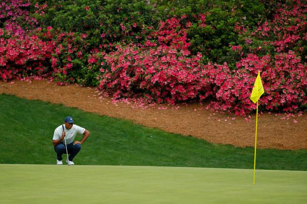 Tiger Woods lines up a putt on the 13th green during the second round of the Masters at Augusta. Photo: Kevin C. Cox