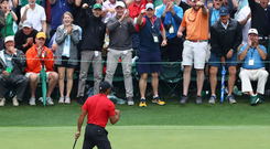 Tiger Woods celebrates his historic Masters victory at Augusta last Sunday. Photo: Curtis Compton