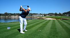 Bird's eye view: Shane Lowry drives off the 18th tee during during yesterday's practice round ahead of this week's US Open at Pebble Beach. Photo: Getty