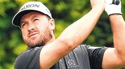 Good day's work: Graeme McDowell is happy with his Pebble Beach start