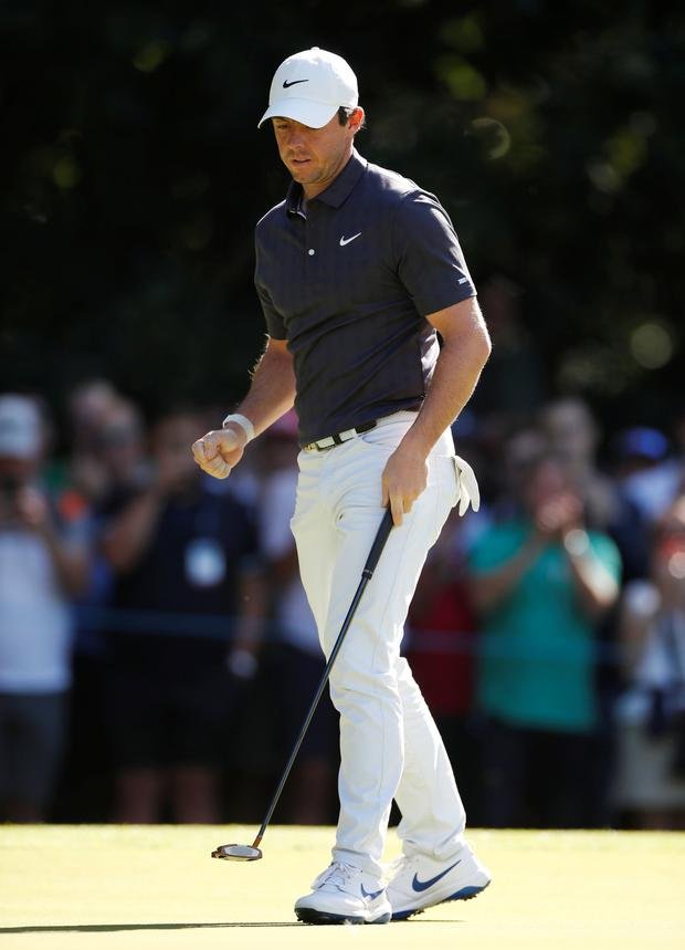 Rory McIlroy celebrates a birdie during yesterday's round at Wentworth. Photo: Action Images via Reuters