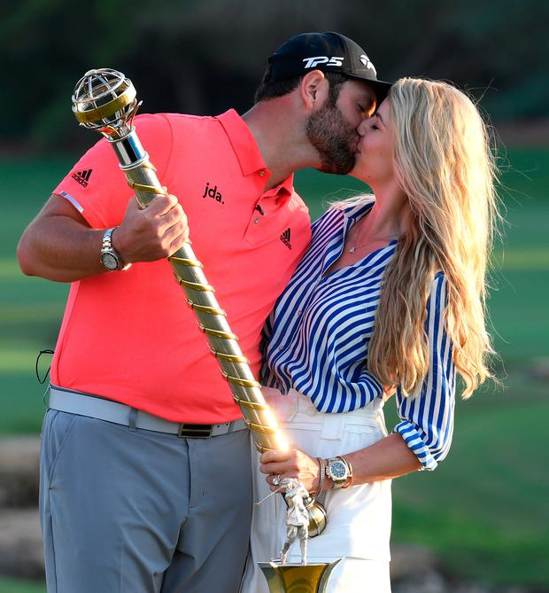 Sealed with a kiss: Jon Rahm poses with his fiancee Kelley Cahill after winning the DP World Tour Championship in Dubai. Photo: Ross Kinnaird/Getty Images