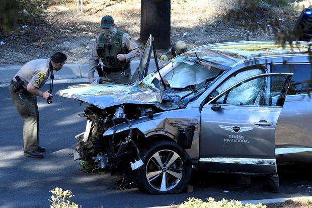 Los Angeles County Sheriff's Deputies inspect the vehicle of golfer Tiger Woods, who was rushed to hospital after suffering multiple injuries, after it was involved in a single-vehicle accident in Los Angeles, California, U.S. February 23, 2021. REUTERS/Gene Blevins TPX IMAGES OF THE DAY
