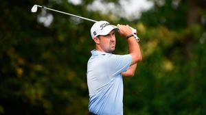 Niall Kearney of Ireland tees off on the seventh hole during the opening round of the Dutch Open