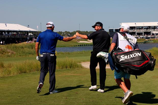 Irish duo Pádraig Harrington and Shane Lowry fist bump after Harrington played his tee-shot on the 17th hole during the final round of the 2021 PGA Championship at the Ocean Course of Kiawah Island last Sunday. Photo: James Squire/Getty