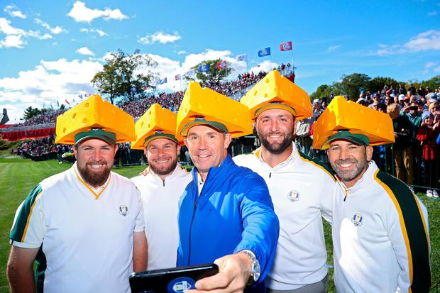Shane Lowry, Tyrrell Hatton, European captain Pádraig Harrington, Jon Rahm and Sergio Garcia pose while wearing cheese head hats during a practice round before Ryder Cup at Whistling Straits. Photo by: Andrew Redington/Getty Images