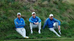 Captain Padraig Harrington, Rory McIlroy and Shane Lowry of Team Europe look on during Friday Afternoon Fourball Matches of the 43rd Ryder Cup at Whistling Straits in Kohler, Wisconsin. (Photo by Warren Little/Getty Images)