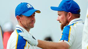 Shane Lowry, right, hugs Rory McIlroy on the 16th green after losing his match to Patrick Cantlay. Photo: Warren Little