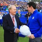 Rory McIlroy of Europe shakes with Jack Nicklaus on the 1st tee before the Singles Matches at the Ryder Cup