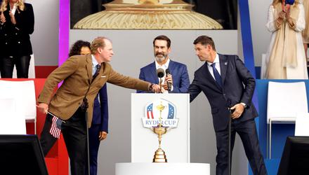 Team Europe captain Padraig Harrington and Team USA captain Steve Stricker shake hands as host Rob Riggle looks on during the opening ceremony REUTERS/Jonathan Ernst TPX IMAGES OF THE DAY