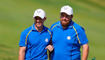 Shane Lowry, right, and Rory McIlroy of Team Europe