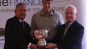 Jack McDonnell receives the Dundalk Scratch Cup from club captain Trevore Giff and sponsor Martin McDonnell of One Finance