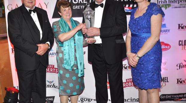 Pictured at the National Greyhound Racing Awards in Curraheen Park are Tom Hayes Minister of State at Dept of Agriculture who presented the Supreme Greyhound of the year Award to Mary Jennings owner of Laughil Blake also included are Phil Meaney chairman