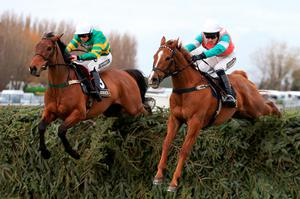 On The Fringe and Jamie Codd (left) get the better of Dineur in the Foxhunters at Aintree yesterday (PA)