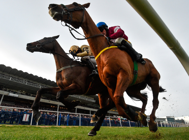Bellshill, with Ruby Walsh up (left) races alongside Road To Respect (Sean Flanagan) on the way to winning the 2019 Irish Gold Cup at Leopardstown. Photo by Ramsey Cardy/Sportsfile