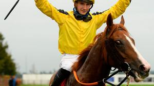 Jockey Ben Coen celebrates after riding Sonnyboyliston to victory in the Comer Group International Irish St. Leger at The Curragh. Photo: Seb Daly/Sportsfile