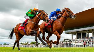 Hurricane Lane (right), with William Buick on board, on their way to winning the Dubai Duty Free Irish Derby