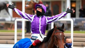 Frankie Dettori celebrates on Mother Earth in the winners enclosure after winning the Qipco 1000 Guineas Stakes. Credit: PA