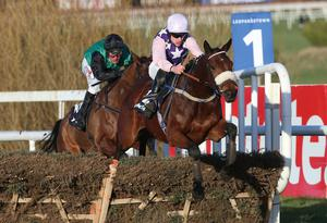 Katie T and Brian Hughes get over the final flight on the way to victory at Leopardstown