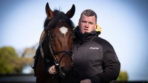 Gordon Elliott with Tiger Roll at Cullentra House Stables. Photo: Patrick McCann/Racing Post