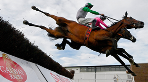 David Mullins tries to sit tight on Russian Diamond (left) but the partnership hits the deck after a mistake at the fourth fence alongside Scheu Time (Gearoid Brouder) in yesterday's Rockshore Novice Chase. Photo: Sportsfile
