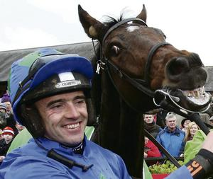 Jockey Ruby Walsh with Hurricane Fly in the parade ring after winning the Stanjames.com event last year.