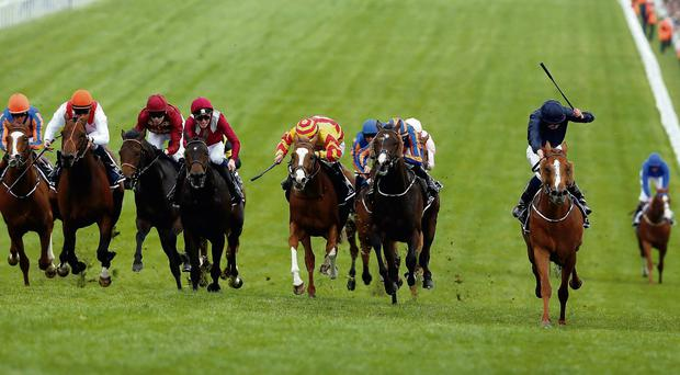 Ruler of the World ridden by Ryan Moore, right, races for the finish line to win The Derby at Epsom