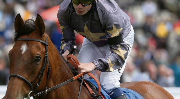 Jockey Jamie Spencer wears a black armband in memory of Henry Cecil as he wins at York yesterday