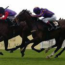 Estimate ridden by Ryan Moore (left) wins the Ascot Gold Cup ahead of Simenon