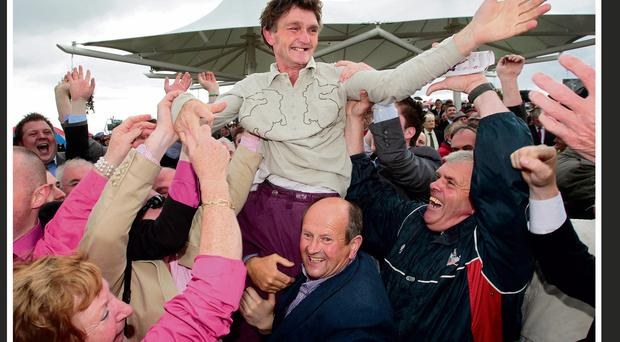 Michael Winters carried shoulder-high by well-wishers after Rebel Fitz's victory last year