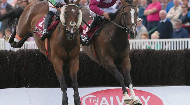 Rathlin ridden by Davy Russell wins The Latin Quarter Steeplechase during day two of the 2013 Galway Summer Festival at Galway Racecourse