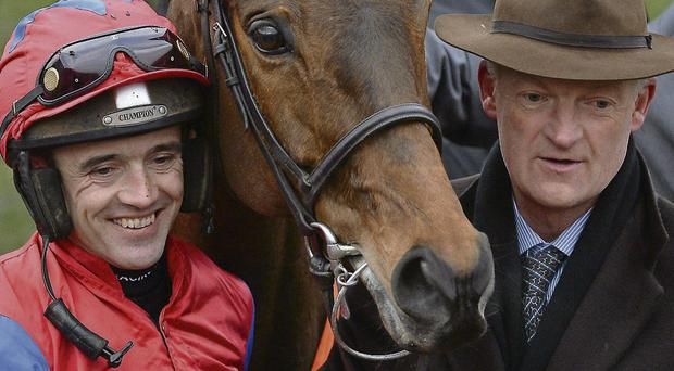 Willie Mullins (right) and Ruby Walsh in the Cheltenham winner's enclosure after Quevega's historic win at the Festival last March.