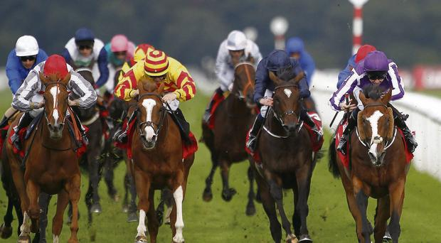 Joseph O'Brien drives Leading Light (far right) to victory from Talent (far left) in Saturday's St. Leger at Doncaster