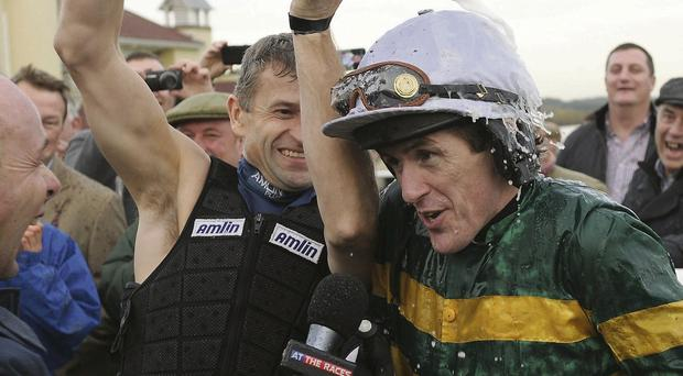 Tony McCoy is doused in champagne by fellow jockey Andrew Thornton after his historic win at Towcester