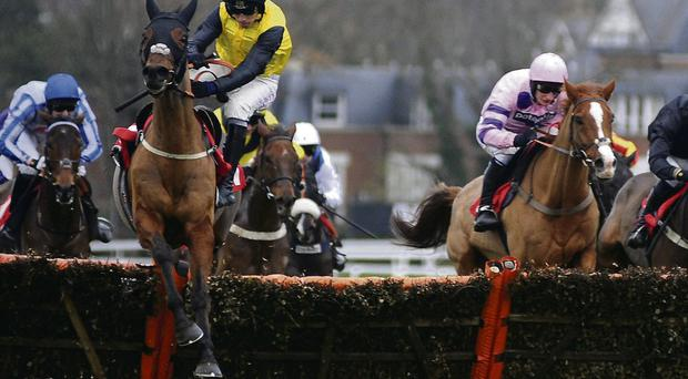 Jockey Leighton Aspell somehow manages to defy gravity aboard the wayward Deep Trouble before straightening up his mount on the run-in to land the Jumeirah Hotels & Resorts December Handicap Hurdle at Sandown on Saturday.