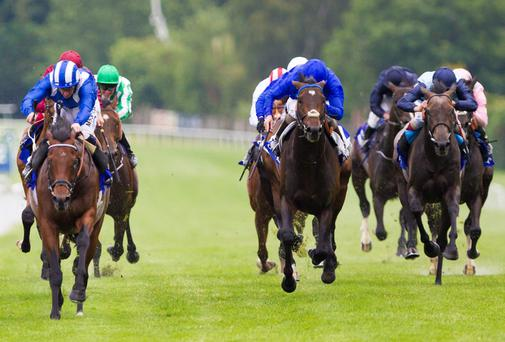 Mukhadram ridden by Paul Hanagan (front left) wins the Coral-Eclipse at Sandown Racecourse, Sandown