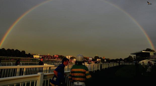 Tony McCoy stands under a rainbow in the parade ring after his final ride of the day at Worcester