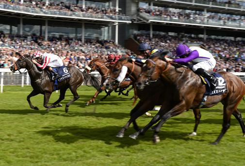 Richard Hughes riding Sole Power (L) winning The Coolmore Nunthorpe Stakes