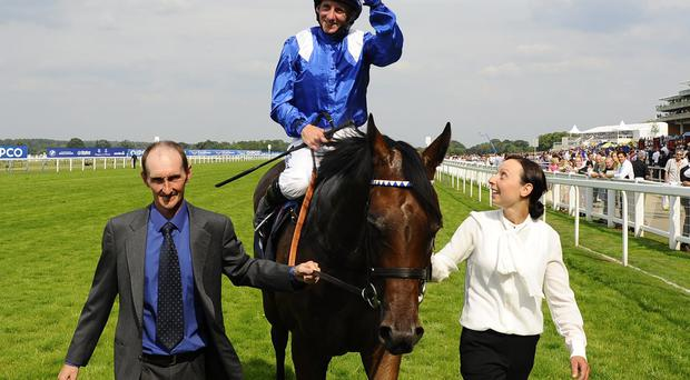 Paul Hanagan celebrates after riding Taghrooda to win The King George VI And Queen Elizabeth Stakes in July
