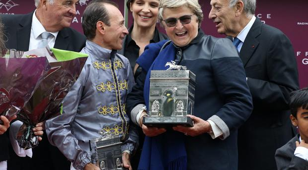 Winner Thierry Jarnet riding Treve, actress Juliette Binoche, trainer Christiane Criquette Head-Maarek pose on the podium during The Qatar Prix de I'Arc de Triomphe at Longchamp racecourse in Paris, France