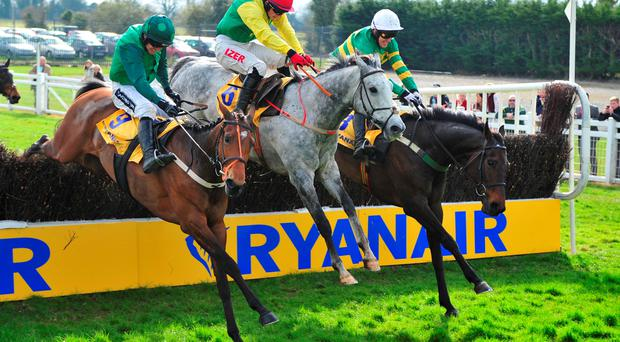 Gitane Du Berlais (Ruby Walsh), Smashing (Johnny Burke) and eventual winner Gilgamboa, under Tony McCoy, jump the last in the Ryanair Gold Cup yesterday