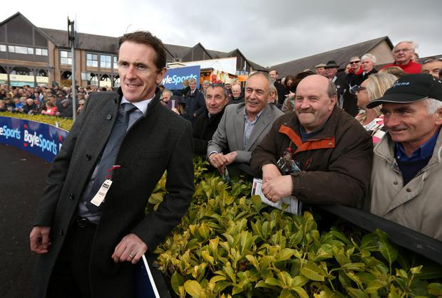 Tony McCoy poses with the crowd at the first day of the Punchestown Festival. Photo: Damien Eagers
